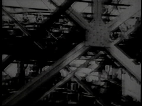 vidéos et rushes de pan cable moving to workers / workers high up / pov from top of bridge - 1928