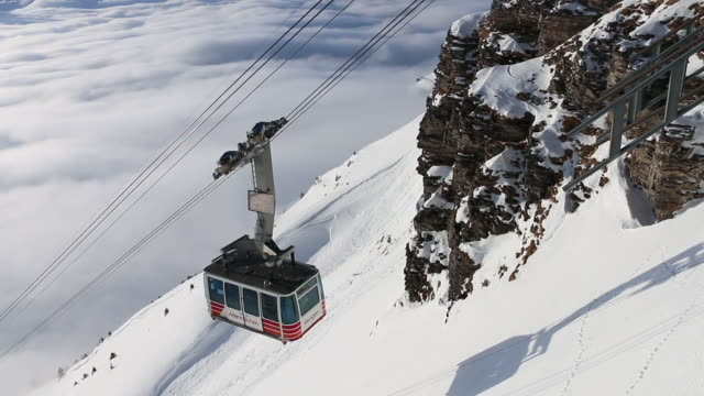 cablecar ascends from valley bottom, winter snow - cable car stock videos & royalty-free footage