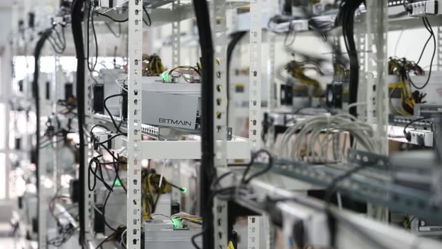 stockvideo's en b-roll-footage met cables are attached to an applicationspecific integrated circuit device and power unit manufactured by bitmain technologies inc at a cryptocurrency... - incheon
