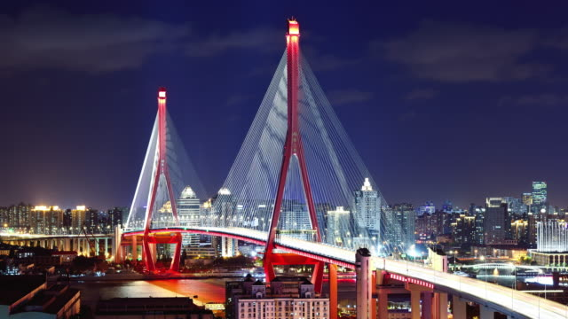4k: cable-stayed bridge at day to night time lapse - cable stayed bridge stock videos & royalty-free footage