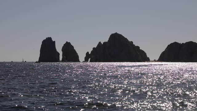 cabo san lucas rock arch is seen during a whale watching tour on january 10, 2021 in cabo san lucas, mexico. every winter the humpback whale arrives... - cetacea stock videos & royalty-free footage