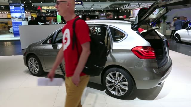 stockvideo's en b-roll-footage met cabrio automobile produced by bayerische motoren werke ag stands on display at the companys stand at the auto mobil international automotive trade... - hybride voertuig