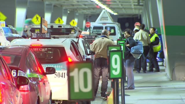 cabs at a taxi stand at o'hare airport on sept 13 2014 in chicago - taxi stand stock videos and b-roll footage