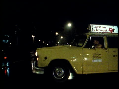 1982 cabs on the streets of nyc at night - 1982 stock videos and b-roll footage