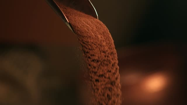 cacao powder pouring - serving scoop stock videos & royalty-free footage