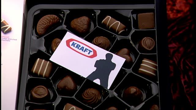 cadbury televiison advert music box of cadbury milk tray chocolates card inside shows kraft 'calling card' - kraft stock videos & royalty-free footage