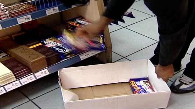 cadbury to be prosecuted over salmonella outbreak; date unknown int chocolate production line chocolate bars packed back in to box cadbury chocloate... - salmonella stock videos & royalty-free footage