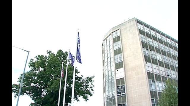 cadbury to be prosecuted over salmonella outbreak; ext r02080601 cadbury flag flying next cadbury factory - salmonella video stock e b–roll