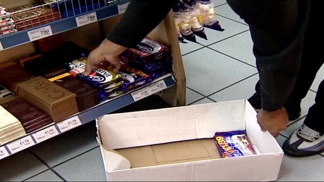 cadbury's chocolate fined for salmonella outbreak; london: int bars of cadbury's chocolate being removed from shop shelves during salmonella scare - salmonella video stock e b–roll