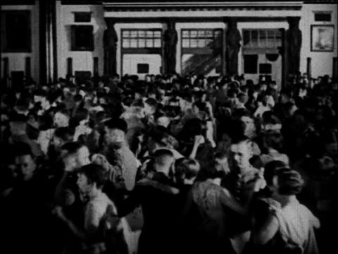 B/W 1920 cadets + dates dancing at graduation dance in large ballroom / West Point, NY / documentary