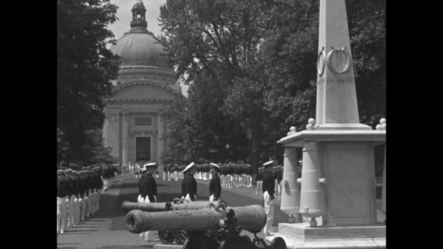 vídeos y material grabado en eventos de stock de cadets from the unites states naval academy march in formation on campus during world war ii / dome of a church / american flag flying - annapolis