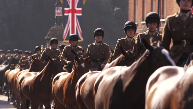 cadets on horseback ride through the streets in windsor, england. - (war or terrorism or election or government or illness or news event or speech or politics or politician or conflict or military or extreme weather or business or economy) and not usa stock videos & royalty-free footage