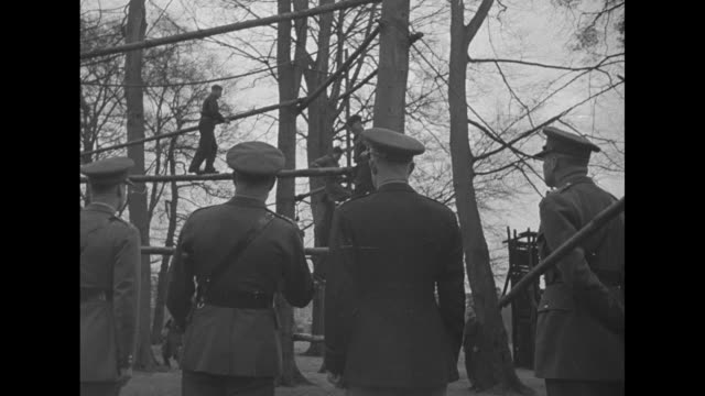 cadets on obstacle course at royal military college move down steep hill on ropes and on wooden supports / vs gen dwight eisenhower watches cadets... - womens army corps stock videos & royalty-free footage