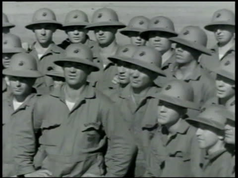 vidéos et rushes de cadets sitting around instructor showing how to throw hand grenade. men listening. grenade in instructor's hand. men laying flat on floor, throwing... - 1942