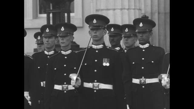 cadets stand in formation in front of building / wider view of cadets standing in formation in front of building / prince edward, duke of kent,... - duke of edinburgh stock videos & royalty-free footage