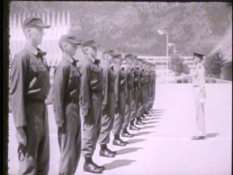 cadets standing in line outside in cadet area at attention drill sergeant calling out drill commands 'about face' cadets following commands marching... - sergeant stock videos & royalty-free footage