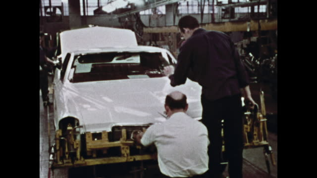 1968 cadillac assembly line montage - film montage stock videos & royalty-free footage