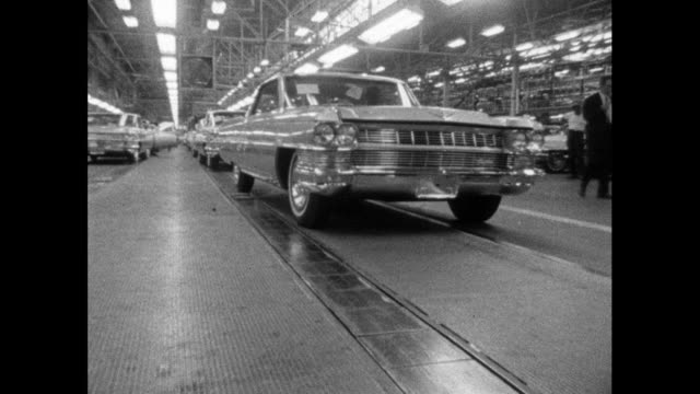 ws cadillac car driving off the production line; 1964 - in a row stock videos & royalty-free footage