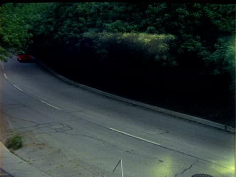cadillac eldorado convertible top down followed by red mg convertible sports coupe top down driving along suburban road at dusk cadillac and mg... - convertible top stock videos & royalty-free footage