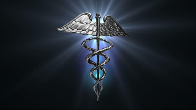 caduceus medical symbol (loop). - caduceus stock videos and b-roll footage