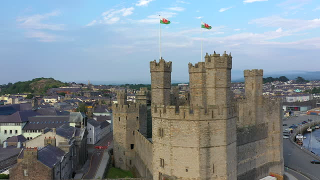 caernarfon castle, caernarfon, gwynedd, wales, united kingdom - national flag stock videos & royalty-free footage