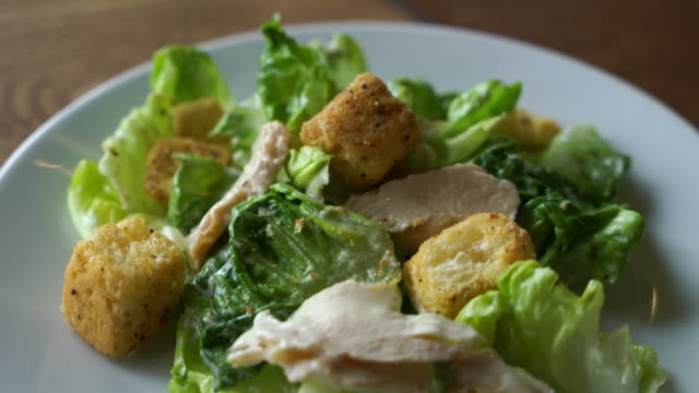 caesar salad with chicken - salad stock videos & royalty-free footage