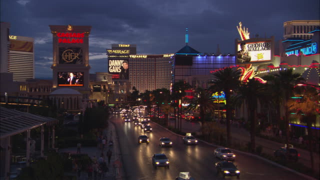 ws caesar's palace hotel and casino at night/ las vegas, nevada - imperial palace hotel stock videos & royalty-free footage