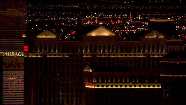 caesars palace lights up the las vegas, nevada night sky. - caesars palace las vegas stock videos and b-roll footage
