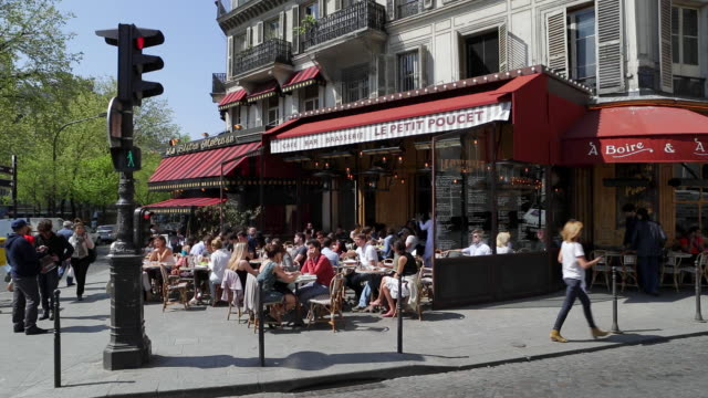 caf_ and street scene in montmartre, paris, france, europe - france stock videos & royalty-free footage