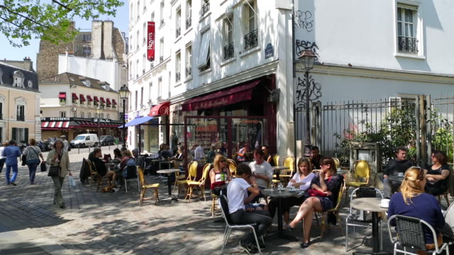 caf_ and street scene in montmartre, paris, france, europe - cafe stock videos & royalty-free footage