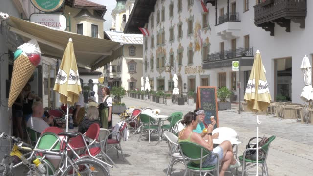 cafe, colourful architecture on speckbacherstrasse and shopping area in st. johann, tyrol, austrian alps, austria, europe - ice cream cone stock videos & royalty-free footage