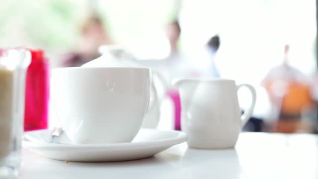 cafe' culture:  a hot cup of tea - cafe culture stock videos and b-roll footage