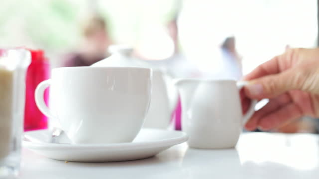 cafe' culture: pouring a cup of tea - cafe culture stock videos and b-roll footage