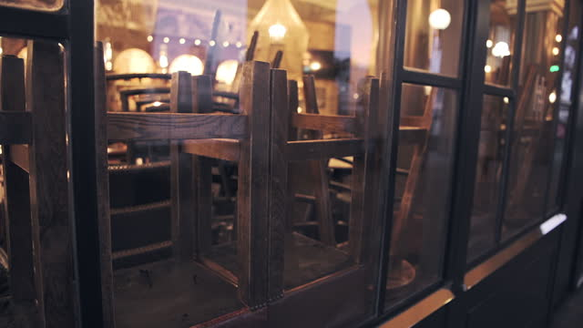 cafe in london closed, forced to shut in covid-19 coronavirus pandemic lockdown in england, showing chairs and stools upside down on tables in restaurant and bar in hospitality industry - no people stock videos & royalty-free footage