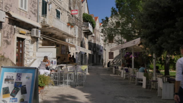 cafe on korcula old town street, korcula, dalmatia, croatia, europe - pavement cafe stock videos & royalty-free footage