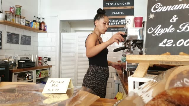 cafe owner wendy birch behind the counter at her business, sista barista, a black female family run coffee shop near waterloo station on july 16,... - owner stock videos & royalty-free footage