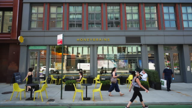 stockvideo's en b-roll-footage met cafe & restaurant sets tables on the sidewalk, which keep social distancing each tables in noho at new york city on june 23 2020 at ny usa. - bar gebouw