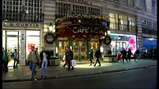 cafe royal in london closes to make way for hotel ext cafe royal entrance as christmas shoppers along street cafe royal sign - cafe royal stock videos and b-roll footage