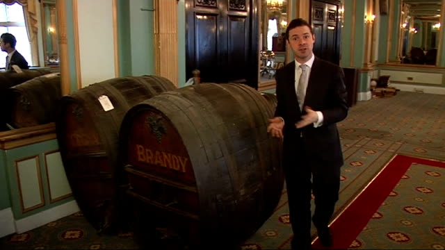 cafe royal in london closes to make way for hotel int brandy barrels report to camera framed photographs of previous visiters to cafe royal including... - cafe royal stock videos and b-roll footage