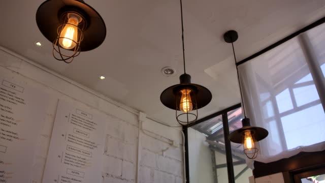 stockvideo's en b-roll-footage met cafe winkel de koffie en dessert, binnen de versieren winkel. - dining room