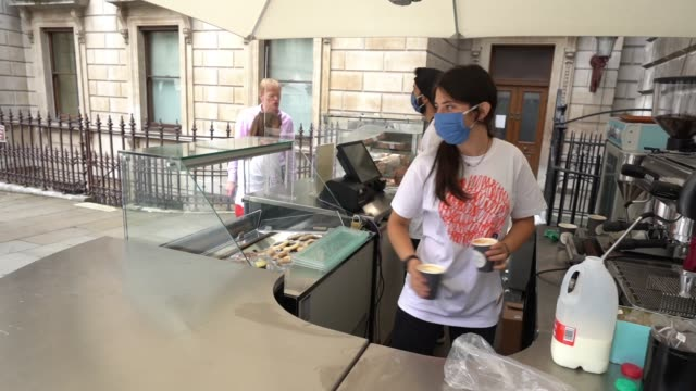 cafe staff wear face masks as they serve a gallery visitor as the gallery reopens to members with social distancing measures in place on july 9, 2020... - cafe stock videos & royalty-free footage