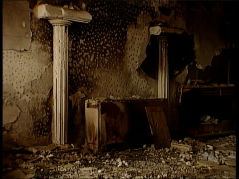 cafe where massacre of ethnic albanian berisha family happened as man along past int gv wreckage from slaughter in cafe fade to roses laid in tribute... - slobodan milosevic stock-videos und b-roll-filmmaterial