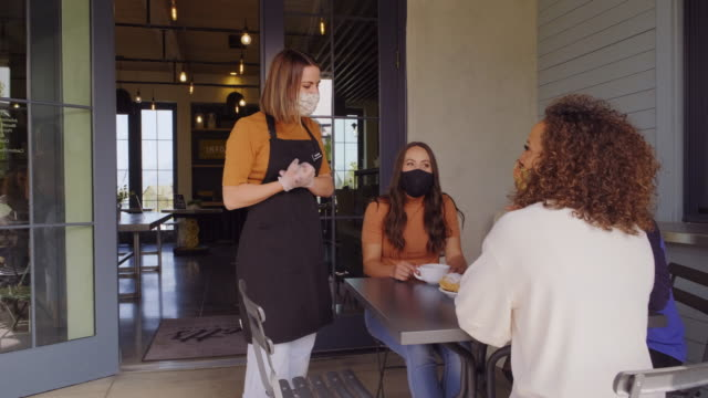 cafe worker with face mask - protection stock videos & royalty-free footage
