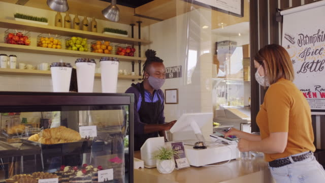 cafe worker with face mask - small group of people stock videos & royalty-free footage