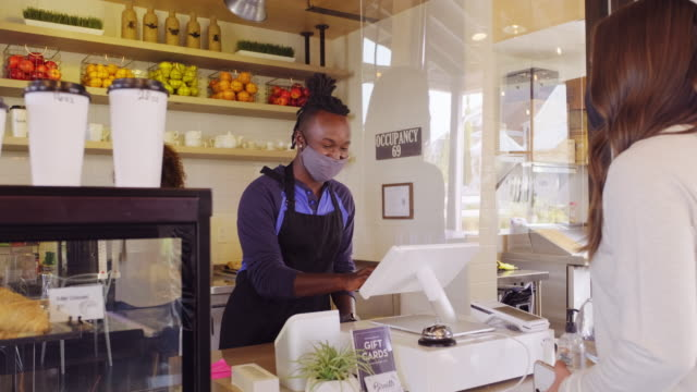 cafe worker with face mask - coffee shop stock videos & royalty-free footage