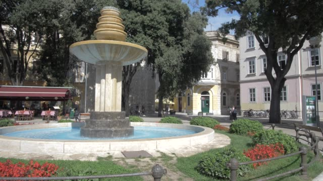 cafes and water fountain in dante square in old town, pula, istria county, croatia, adriatic, europe - square stock videos & royalty-free footage