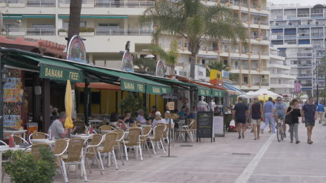cafes on paseo maritimo, marbella, andalucia, spain, europe - pavement cafe stock videos & royalty-free footage