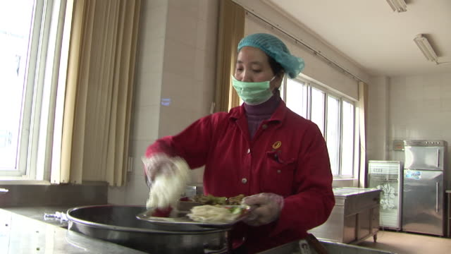 ms cafeteria worker putting food on tray and giving it to man/ man walking away with tray/ fuzhou, china - cafeteria worker stock videos and b-roll footage