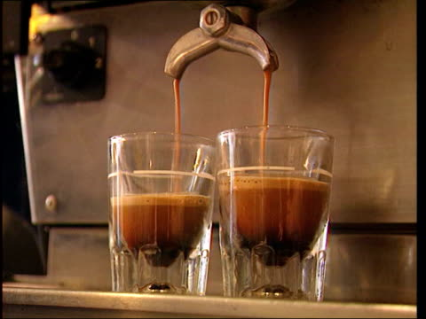 caffeine risk to pregnant women lib ms coffee beans in glass container tilt down dispenser ms espresso being poured out of machine into two glasses - caffeine stock videos & royalty-free footage