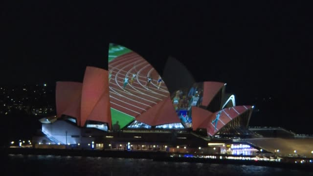 stockvideo's en b-roll-footage met cahty freeman's iconic sydney olympic victory is projected onto the sydney opera house marking 20 years since the race, as officials enlist cutting... - in dienst gaan
